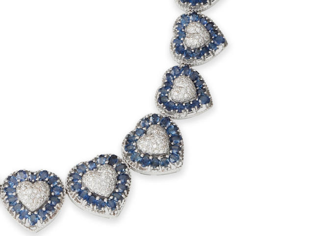 A sapphire and diamond necklace, bracelet, earring and ring suite