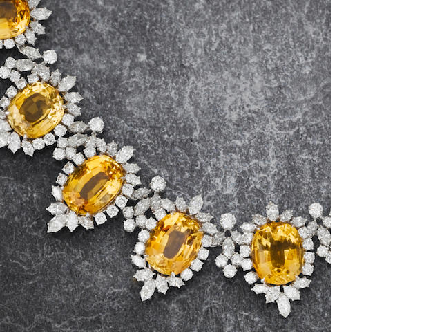 A citrine and diamond necklace, bracelet, earring and ring suite