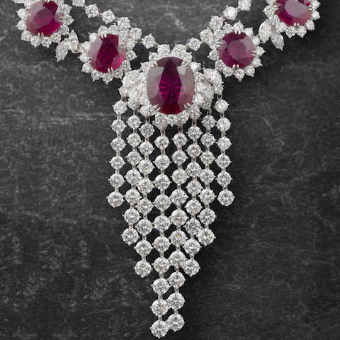An impressive ruby and diamond necklace, bracelet, earring and ring suite