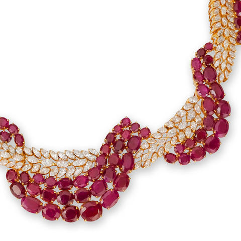 A ruby and diamond necklace, bracelet and ring suite