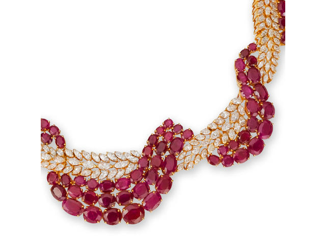 A ruby and diamond necklace, bracelet and ring suite (3)