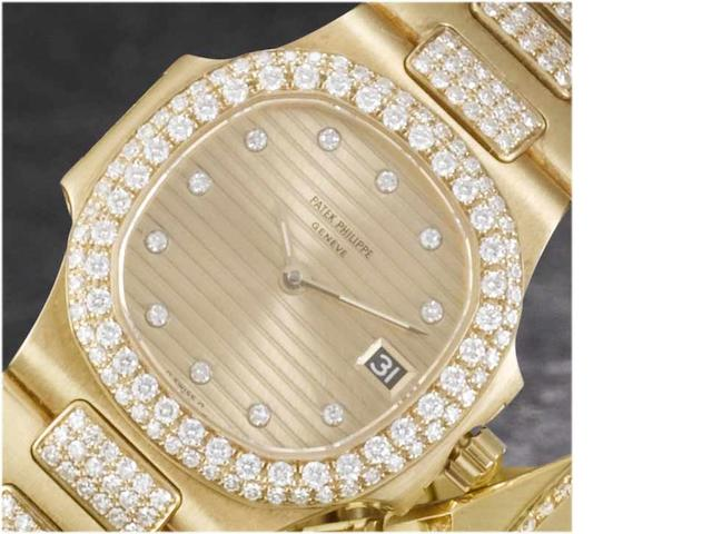 Patek Philippe. A fine lady's 18ct gold diamond set calendar bracelet watch Nautilus, recent