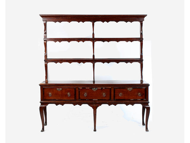 A late 18th century oak and mahogany banded dresser,