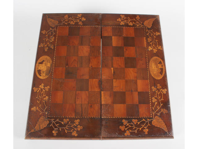 A mid-19th century Irish arbutus and yew veneered and boxwood inlaid chess and backgammon board/box