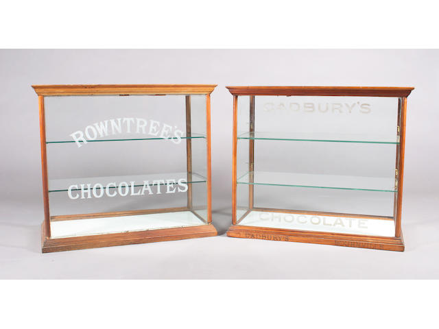 Two very similar late Victorian mahogany framed counter top shop display cabinets for chocolate