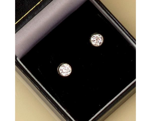 A pair of single stone diamond earstuds