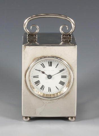 A silver carriage timepiece By William Comyns, 1910,