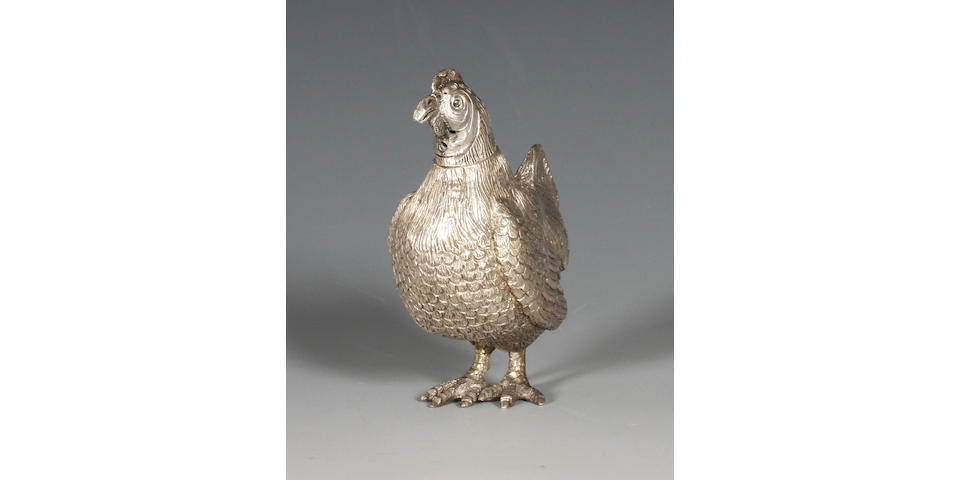 A late Victorian silver novelty pepper in the form of a hen By Thomas Johnson, 1882,