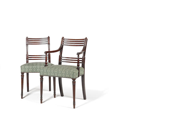 A set of eight George III mahogany Dining Chairs with four Chairs of later date in the Sheraton styl