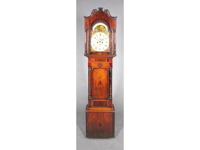 A 19th century oak, mahogany and inlaid longcase clock