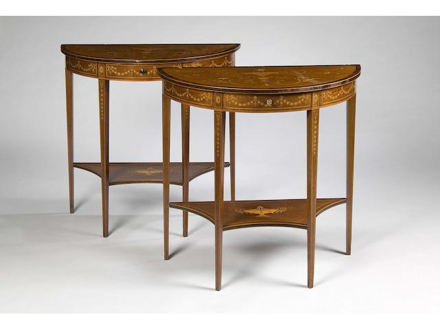 A pair of Edwardian mahogany rosewood cross-banded boxwood lined and marquetry inlaid demi-lune side tables