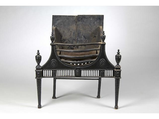 A Regency black painted cast iron fire basket
