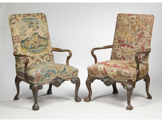 A near pair of George II style walnut and tapestry upholstered open armchairs