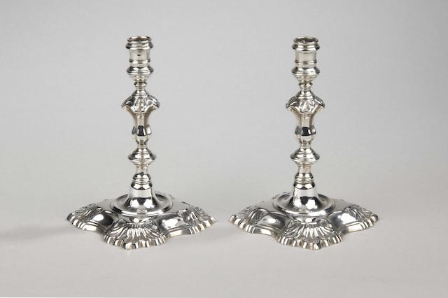 A pair of George II style cast dwarf tapersticks by Sebastian Harry Garrard, London 1934,