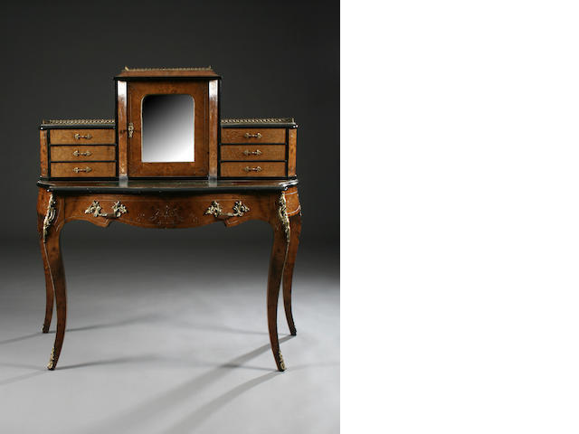 A mid Victorian figured walnut and ebonised bonheur du jour