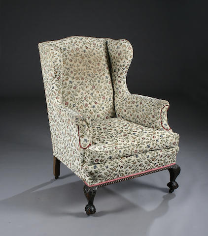 A substantial George III style upholstered mahogany wing armchair