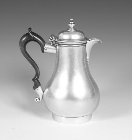 A George II silver hot water pot By George Wickes, 1745,