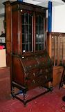 An early 20th century oak bureau bookcase