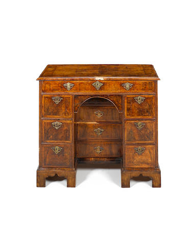 A Queen Anne walnut crossbanded and featherbanded Kneehole Desk