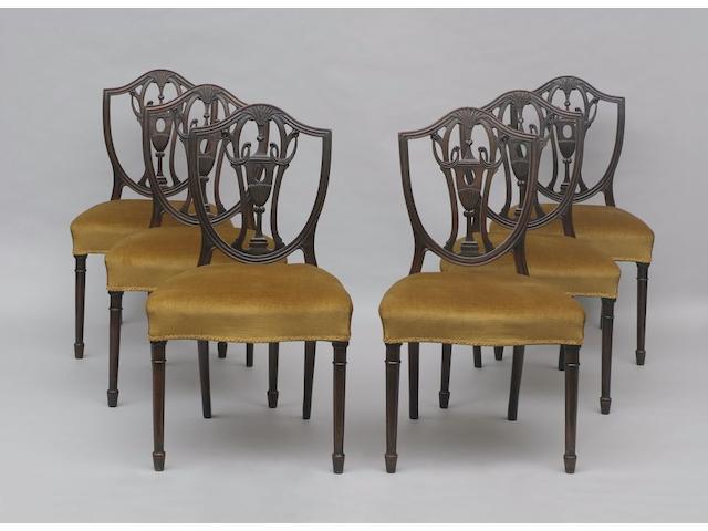A set of six mahogany shield back dining chairs,