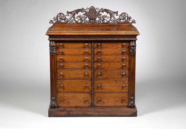 A good mid Victorian mahogany dual collectors cabinet Makers C J Freeman, 37 London St, Norwich