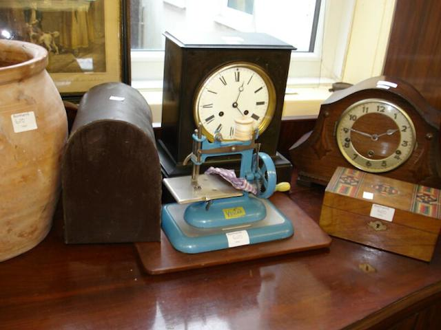 A late Victorian black slate mantel clock,