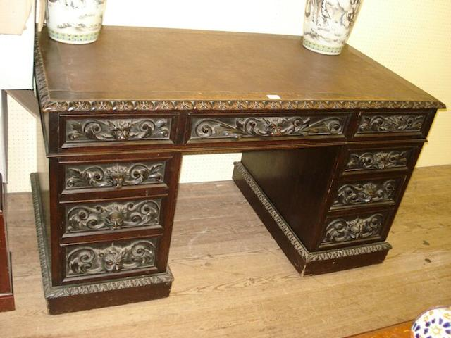 A late 19th century oak pedestal desk,