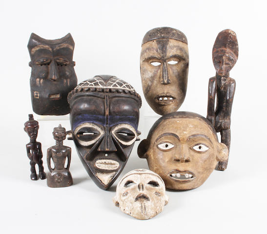 A group of five African tribal carved, stained and painted wood masks