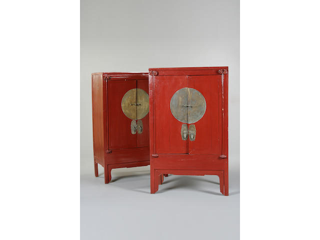 A matched pair of Chinese red painted cabinets,