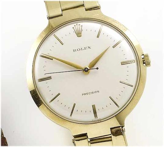 Rolex. An 9ct gold centre seconds bracelet watch1950's