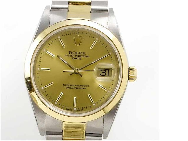 Rolex. A stainless steel and gold centre seconds calendar bracelet watch Date, 2003