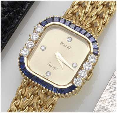 Piaget. A fine lady's 18ct gold diamond and sapphire set bracelet watch retailed by Asprey 1980's