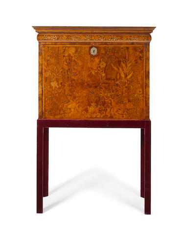 A William and Mary walnut, crossbanded and floral marquetry Escritoire on later Stand