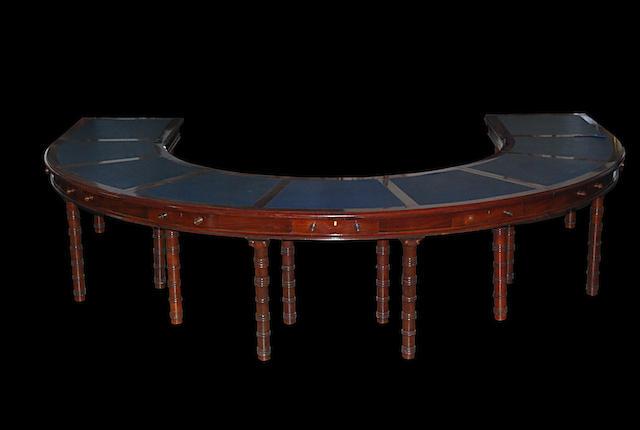 A mahogany horseshoe-shaped boardroom table, circa 1900