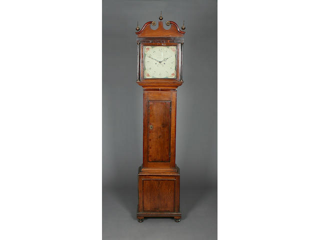 An early 19th Century oak and mahogany-cased 8-day painted dial longcase clock I. Joyce of Whitchurch sold with two weights, pendulum and winder