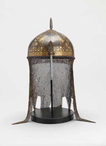 A gold koftgari steel Helmet Persia or Deccan, mid 17th Century