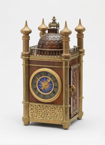 A Russian ? wood and brass mounted Clock