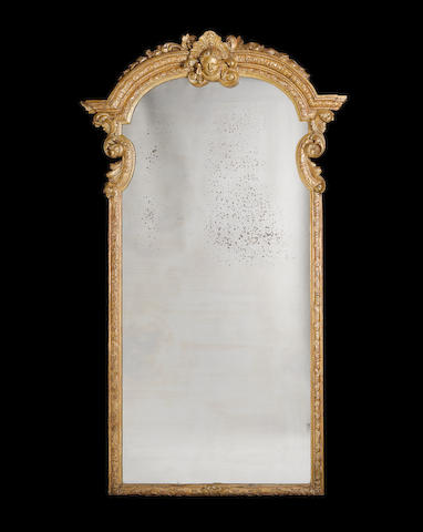 A carved giltwood Pier Mirror in the Queen Anne style