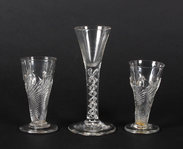 Two dwarf ale glasses and a mercury twist wine glass (minute rim chip)