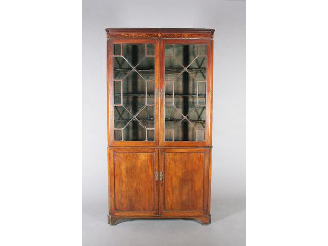 A large George III mahogany floorstanding corner cupboard
