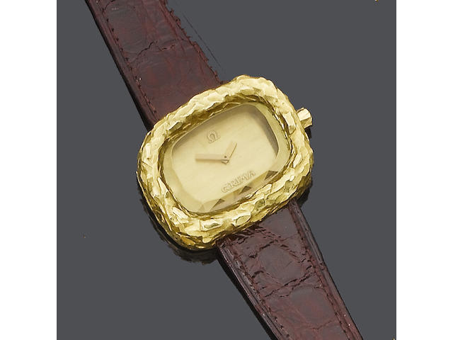 "A gold ""Teak"" watch, by Grima,"