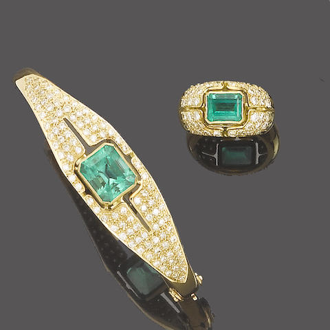 An emerald and diamond bangle, ring and earclip suite