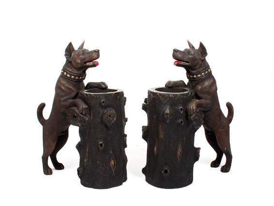 A pair of carved dog stick stands