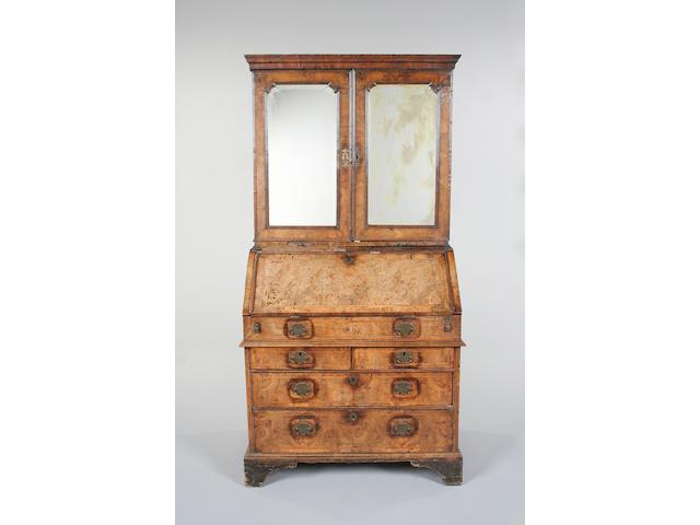 A George II walnut bureau cabinet