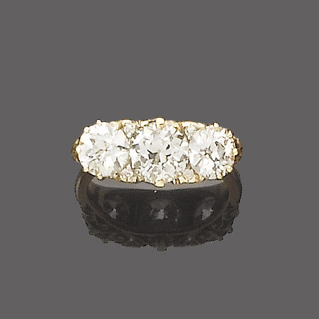 A late 19th century diamond three-stone ring,