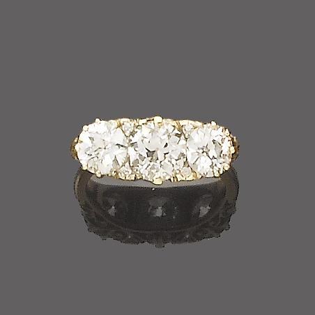 A late 19th century diamond three-stone ring,