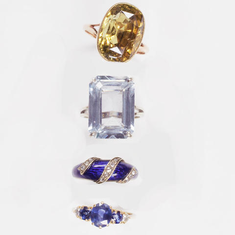 A collection of four gem set rings