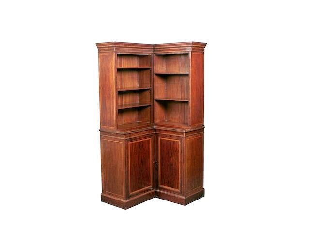 An early 20th century Edwards & Roberts mahogany corner bookcase