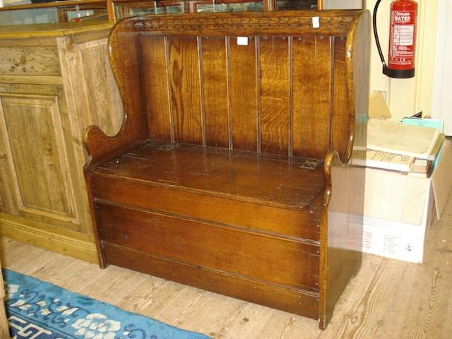 A reproduction oak hall seat