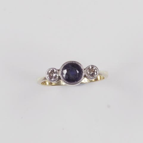 A sapphire and diamond three stone ring,